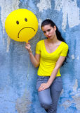 Teen girl with sad smiley balloon Royalty Free Stock Photos