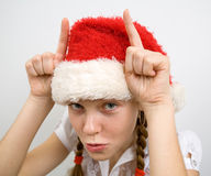 Teen girl in Santa hat Royalty Free Stock Photography