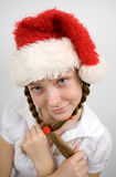 Teen girl in Santa hat Royalty Free Stock Image
