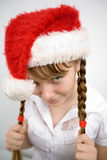 Teen girl in Santa hat Stock Image