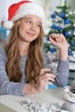 Teen girl in Santa hat. Portrait of smiling teen girl in Santa hat Royalty Free Stock Photos