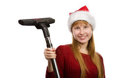 Teen girl in santa hat with vacuum cleaner Stock Photo