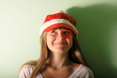 Teen girl with Santa's red cap.look up Royalty Free Stock Photography