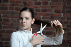 Teen girl with scissors Royalty Free Stock Photography