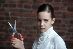 Teen girl with scissors Royalty Free Stock Images