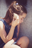 Teen girl with sea shell Royalty Free Stock Images