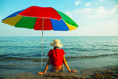 Teen girl seating at a beach Stock Photography