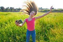 Teen girl selfie video photo spring meadow. Teen girl selfie video photo in spring meadow moving hair stock photo