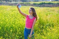 Teen girl selfie video photo spring meadow. Teen girl selfie video photo in spring meadow stock images