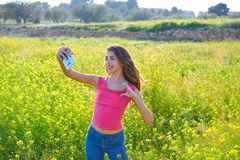 Teen girl selfie video photo spring meadow. Teen girl selfie video photo in spring meadow royalty free stock photo