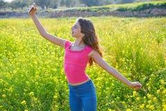 Teen girl selfie video photo spring meadow. Teen girl selfie video photo in spring meadow royalty free stock image