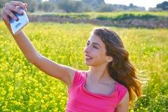 Teen girl selfie video photo spring meadow. Teen girl selfie video photo in spring meadow stock photos