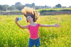 Teen girl selfie video photo spring meadow. Teen girl selfie video photo in spring meadow moving hair royalty free stock photos