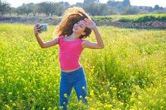 Teen girl selfie video photo spring meadow. Teen girl selfie video photo in spring meadow moving hair royalty free stock image