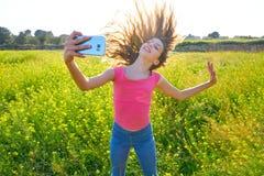 Teen girl selfie video photo spring meadow. Teen girl selfie video photo in spring meadow moving hair stock photos