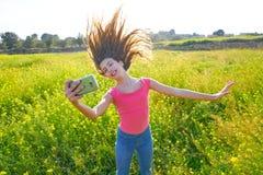 Teen girl selfie video photo spring meadow. Teen girl selfie video photo in spring meadow moving hair stock images