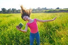 Teen girl selfie video photo spring meadow. Teen girl selfie video photo in spring meadow moving hair royalty free stock photo