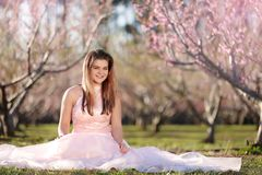 Teen girl in a field of cherry blossoms royalty free stock images