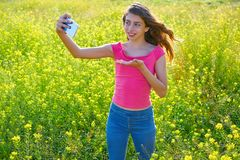 Teen girl selfie video photo spring meadow. Teen girl serfie video photo in spring meadow gesturing stock image