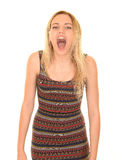 Teen girl shouting. Teen aged girl with long blond hair shouting and looking at camera Stock Image
