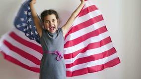 Teen girl shouting holding American flag usa. Teen  girl shouting holding American flag usa stock video