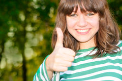 Teen girl show thumb up Stock Photo