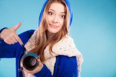 Teen girl showing empty mug Royalty Free Stock Image