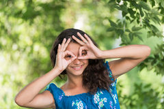 Teen girl showing sign  on  nature Stock Photography