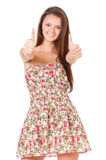 Teen girl showing thumbs Stock Photography