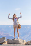 Teen girl showing victory in front of canyon Royalty Free Stock Photography