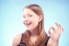 Teen girl shows ok Stock Photos