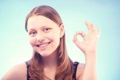 Teen girl shows ok Royalty Free Stock Image
