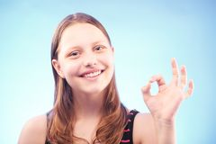 Teen girl shows ok Royalty Free Stock Images