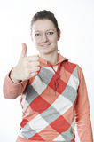 Teen girl shows thumbs up Stock Image
