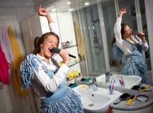 Teen girl singing. In the bathroom Stock Photography