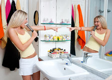 Teen girl singing in bathroom Royalty Free Stock Photography