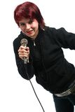 Teen girl singing with a microphone Stock Image