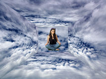 Teen Girl Sits Suspended in the Clouds Stock Photography