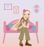 Teen girl sitting alone in her room Royalty Free Stock Photos