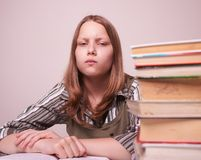 Teen girl sitting with books Stock Photos
