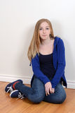 Teen girl sitting on the floor Royalty Free Stock Image