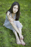 Teen girl sitting on grass Royalty Free Stock Photo