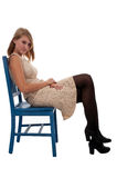 Teen Girl Sitting In A Blue Chair Royalty Free Stock Photo