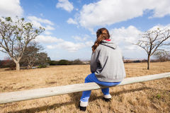 Teen Girl Sitting Outdoors Countryside Royalty Free Stock Photography
