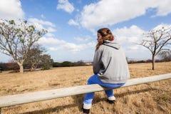 Teen Girl Sitting Outdoors Stock Image