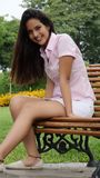Teen Girl Sitting On Park Bench Stock Images
