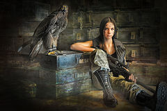 Teen girl sitting with a rifle Royalty Free Stock Images