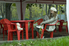 Teen girl sitting on street caffe Stock Photos