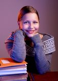 Teen girl sitting at table with books Stock Photography