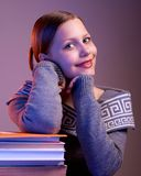 Teen girl sitting at table with books Royalty Free Stock Photos